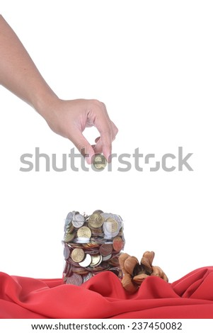 Financial education concept with man hands putting coins isolated on white background - stock photo