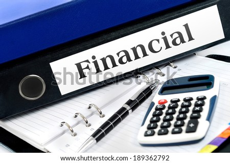 Financial folder with office tools - stock photo