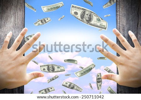 Financial Freedom concept. Opening a door and see many dollar bills floating in the sky. Leave a blank for copy space in the middle. - stock photo