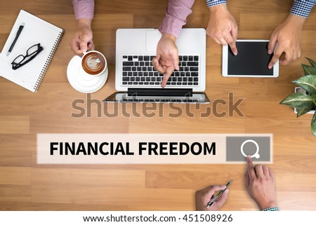 FINANCIAL FREEDOM man touch bar search and Two Businessman working at office desk and using a digital touch screen tablet and use computer, top view - stock photo