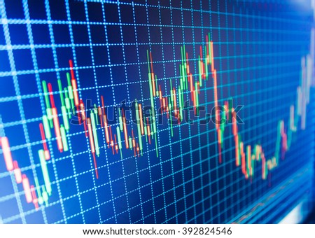 Financial graph on a computer monitor screen. Finance concept. Analysing stock market data on a monitor. Share price quotes. Data on live computer screen. Business analysis diagram.   - stock photo