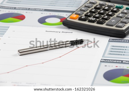Financial graphs analysis on table - stock photo