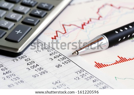 Financial graphs and charts analysis - stock photo