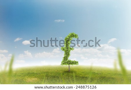 Financial growth and success on a green summer natural green grass landscape with a single trees in the shape of a money sign showing a business concept of growing prosperity and investments - stock photo