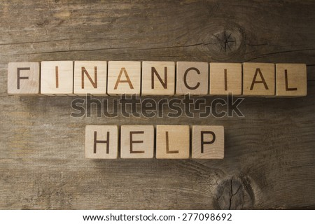 Financial help text on a wooden background - stock photo