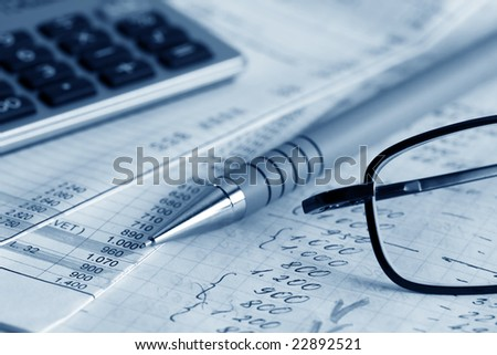 Financial information in the checkbook. - stock photo