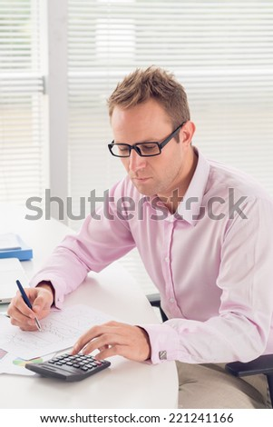 Financial manager working on report - stock photo