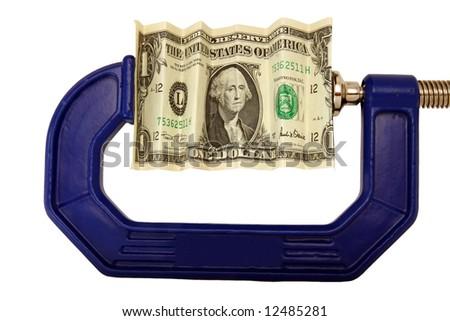 Financial or economic metaphor:  dollar bill in clamp - stock photo
