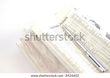 Financial or economy concept with newspaper showing Mutual Funds and silver pen laying on top. Low depth. - stock photo
