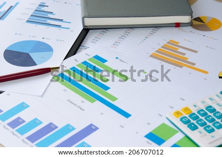 Financial papers,  and office supplies closeup