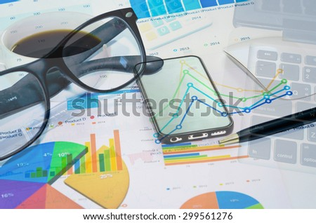 Financial papers, computer and office supplies closeup.business Concept