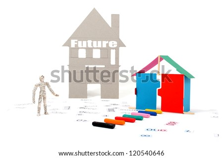 Financial planning for your future.  Manikin man standing in numbers.  Pathway to a small house with a larger house in the future.