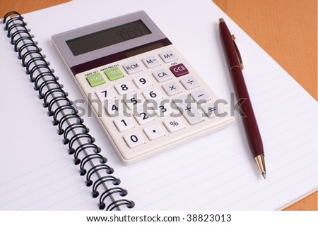 Financial Planning Notepad with Color Coordinated Calculator and Pen - stock photo