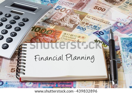 Financial planning - Stack of Hong Kong dollar or banknotes with handwriting notepad and calculator conceptual - stock photo