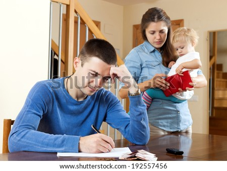 Financial problems in family of three. - stock photo