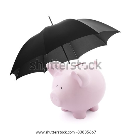 Financial protection. Piggy bank with umbrella - stock photo