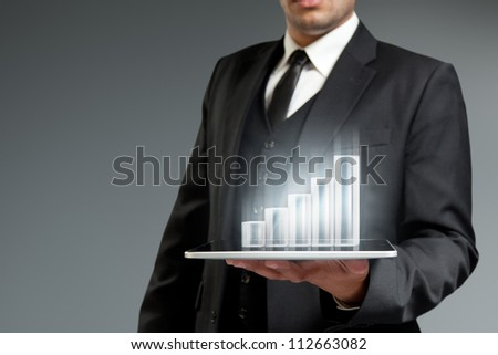 Financial report  & statistics. Future technology business. Holographic bar graph on tablet pc. Touch pad interface collection. - stock photo