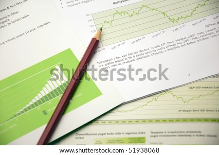 Financial reports and a pencil - stock photo