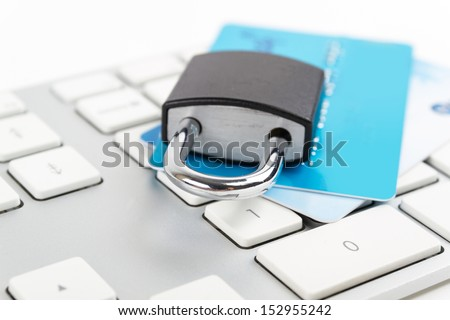 Financial Security Concept. Credit card and lock on the keyboard.  - stock photo