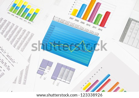 Financial statements and line chart. - stock photo