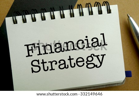 Financial strategy memo written on a notebook with pen - stock photo