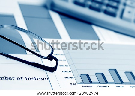 Financial work with stock market reports. - stock photo