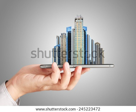 Find a new home inside your smart phone, Real estate - stock photo