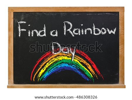 Find a rainbow day with a hand drawn colorful rainbow written in white chalk on a black chalkboard isolated on white
