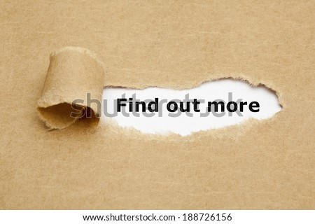 Find out more, appearing behind torn brown paper. - stock photo