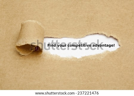 Find your competitive advantage! appearing behind torn brown paper. - stock photo