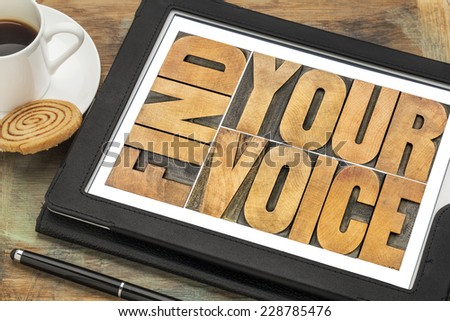 find your voice creativity concept - word abstract in letterpress wood type on a digital tablet with a cup of coffee - stock photo