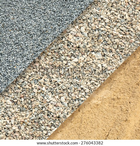 Fine and coarse gravel and sand for background - stock photo
