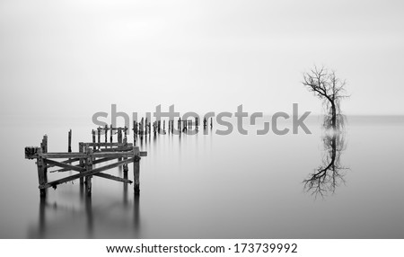 Fine art long exposure landscape of decayed pier - stock photo