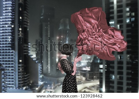 Fine art photo of a beautiful woman in front of a buildings
