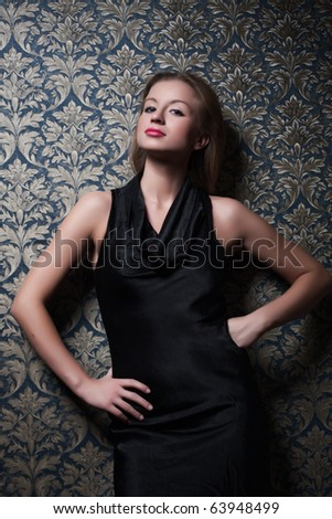 Fine art photo of a fashion woman in a luxurious interior - stock photo