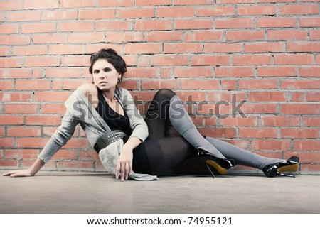 Fine art photo of a stylish fashion brunette beauty - stock photo