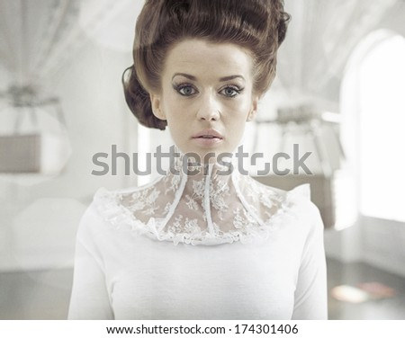 Fine art photo of a young fashion lady in a stylish interior - stock photo