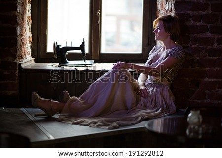 Fine art photo of a young fashion lady posing in old pub. - stock photo