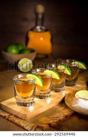 Fine art photo of alcohol liquor tequila and shot glasses - stock photo