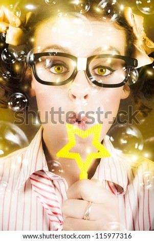 Fine Art Photo On The Face Of A Beautiful Female Geek Blowing Soap Bubble During A Birthday Party Celebration - stock photo