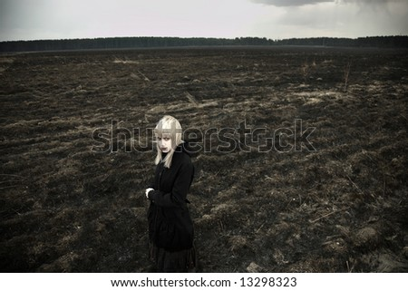 Fine art portrait of elegant girl on black field. - stock photo