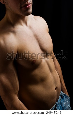 Fine art portrait of muscular male bodybuilder - stock photo