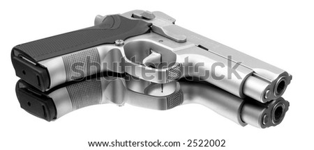 Fine automatic pistol with a perfect reflection - stock photo