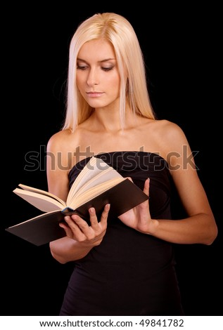Fine blonde reads book, it is isolated on black background. - stock photo