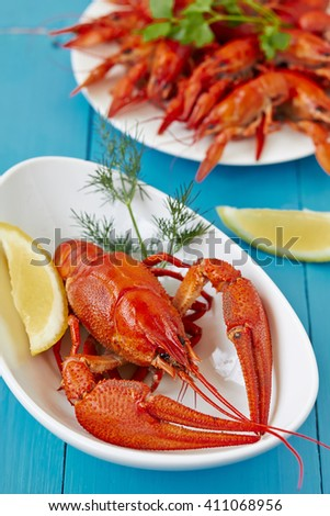 Fine crustacean for dinner. Boiled lobster and crayfish with lemon.  - stock photo