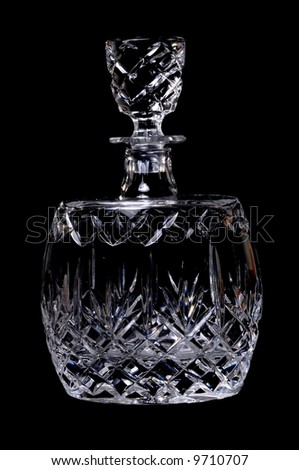 Fine cut crystal glass isolated over black - stock photo