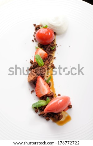 Fine dining dessert, Strawberry ice cream, chocolate mousse and spices - stock photo
