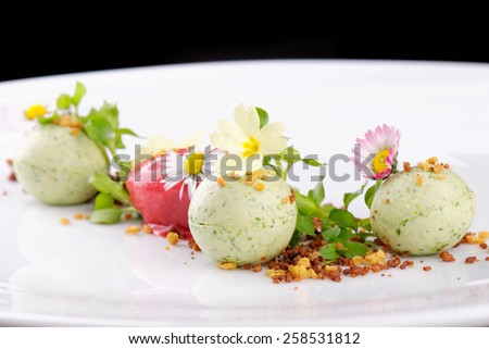 Fine dining dessert, Strawberry/Kiwi ice cream, mousse and spices - stock photo