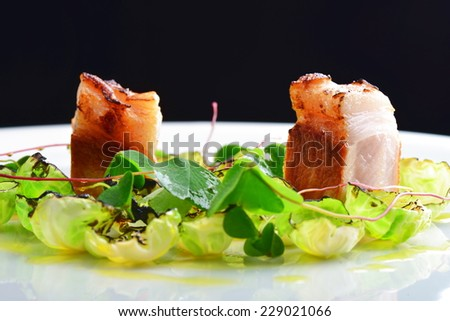 Fine Dining, Gourmet grilled pork loin on  Brussels sprouts with fresh herbs - stock photo