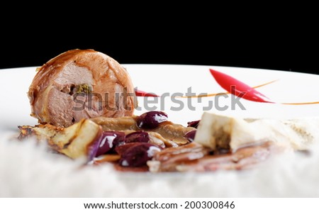 Fine dining, gourmet Main Entree Course Grilled Lamb steak with olives and aubergines - stock photo